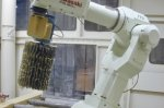 Robotic sanding with sanding brushes Robot arm for sanding or deburring Kawasaki - Cosma Machine Factory